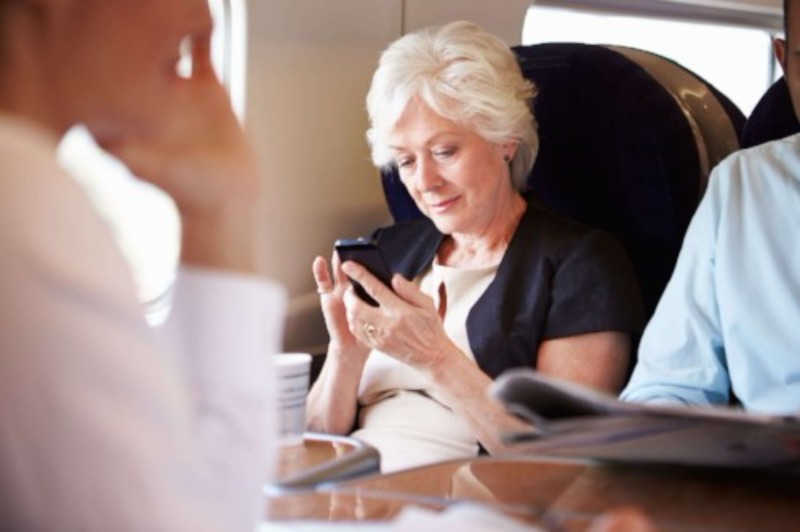 woman-on-train-using-phone